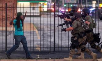 Militarized police vs black man in Ferguson, Missouri