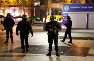 French police stand guard outside the national soccer stadium