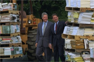 Bill Clinton and Al Gore examine stacks of paperwork at a National Performance Review event in 1993