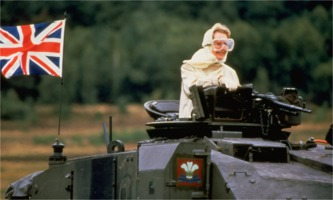 Margaret Thatcher posing on tank