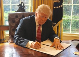 Trump signing Executive Order 13780