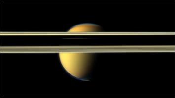 Titan behind Saturn_s rings